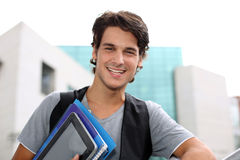 College student holding notebooks Stock Image