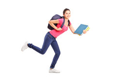 College student in a hurry running with notebooks. Full length portrait of a college student in a hurry running with notebooks  on white background Royalty Free Stock Photos