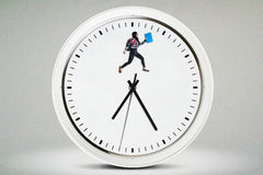College student jumps on the clock Royalty Free Stock Photos