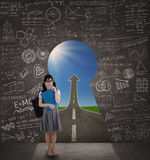 College student with a keyhole to success Royalty Free Stock Photography