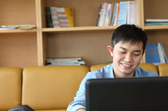 College student with laptop. Indoor and smiling Stock Images
