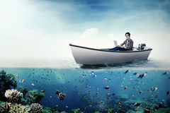 College student with laptop on boat Stock Image