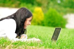 College student with laptop on the grass Royalty Free Stock Photos