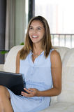 College student with laptop, laughing. Stock Photography