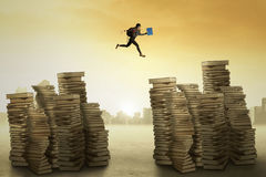 College student leaps over the books Stock Photography