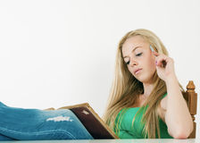 College student learning at desk at home, Royalty Free Stock Photo