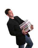 College Student Lugging Books Stock Images