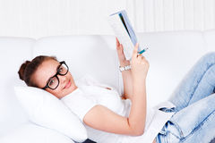 College student lying on sofa Stock Photo