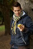 College student with mp3 player outdoors Royalty Free Stock Photo