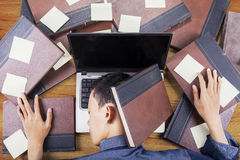 College student napping on laptop Stock Images