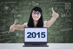 College student with numbers 2015 on laptop Royalty Free Stock Images