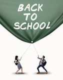 College student pulling a banner isolated Royalty Free Stock Photo