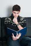 College student reading a book Royalty Free Stock Photo