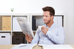 College student reading job market Royalty Free Stock Photography