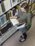 College Student Reading In Library Royalty Free Stock Photography