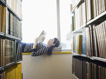 College Student Reading In Library Royalty Free Stock Photos