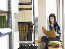 College Student Reading In Library Royalty Free Stock Photo