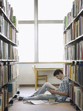 College Student Reading In Library Stock Photo
