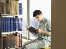 College Student Reading In Library Stock Images