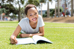 college student reading outdoors royalty free stock photos