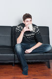 College student relaxing drinking tea Stock Photography