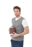 College student with rugby ball. Handsome college student holding rugby ball in hand royalty free stock photo