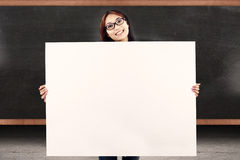 College student showing copy space. Female college student showing empty copy space in front of blackboard Stock Photos