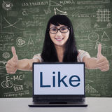 College student showing like button Stock Photo