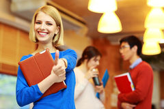 College student showing thumbs up Royalty Free Stock Images