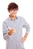 College student shows forefinger. Smiling latin student with black glasses holding forefinger. Isolated on white background, mask included Royalty Free Stock Image