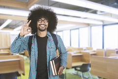 College student shows ok sign in classroom Royalty Free Stock Image
