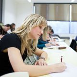 College student sitting in a classroom Stock Image