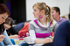 College student sitting in a classroom Stock Photo