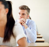 College student sitting in a classroom. Young, college student sitting in a classroom during class Stock Photos