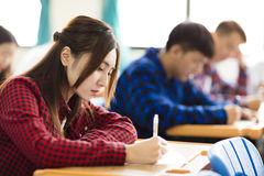 College student sitting and exam in the classroom. Female college student sitting and exam in the classroom Stock Images