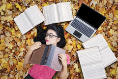 College Student Sleeping on The Autumn Leaves Stock Image