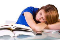College Student Sleeping on her Desk Stock Photo