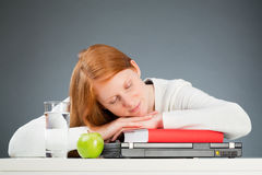 College Student Sleeping on Her Desk Royalty Free Stock Photos