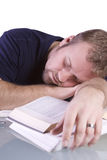College Student Sleeping on his Desk Stock Photo