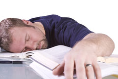 College Student Sleeping on his Desk Royalty Free Stock Photography