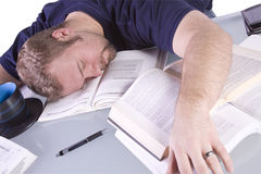 College Student Sleeping on his Desk Royalty Free Stock Photo