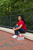 College student studying on campus. College student sitting outside on campus Royalty Free Stock Image