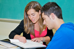 College student studying in classroom. Hispanic college students studying in classroom Royalty Free Stock Image
