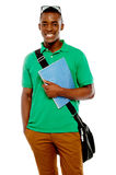College student with sunglasses over his head. Holding spiral notebook Royalty Free Stock Photo