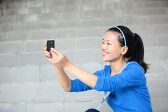 College student take photo with phone Stock Image