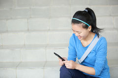 College student use cellphone Royalty Free Stock Image