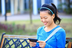 College student use smart phone Royalty Free Stock Image