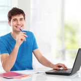 College student using his laptop royalty free stock image