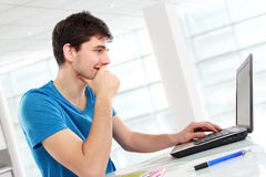 College student using his laptop Royalty Free Stock Photo