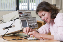 College student using oscilloscope probes Royalty Free Stock Images